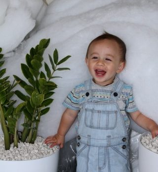 A happy toddler enjoying the benefits of a dry home due to insulation